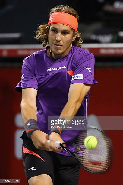 Lukas Lacko of Slovakia in action during men's quarter final singles match against Milos Raonic of Canada during day five of the Rakuten Open at...