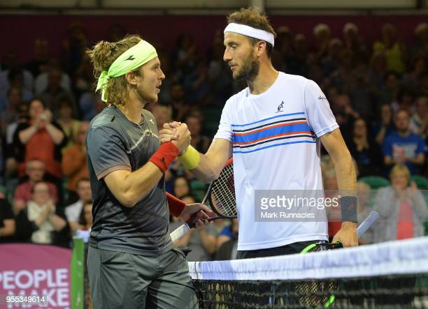 Lukas Lacko of Slovakia is congratulated by Luca Vanni of Italy at match point in the singles final of The Glasgow Trophy at Scotstoun Leisure Centre...