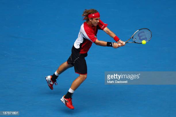 Lukas Lacko of Slovakia plays a backhand in his third round match against Rafael Nadal of Spain during day five of the 2012 Australian Open at...