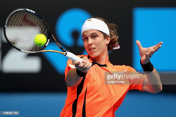 Lukas Lacko of Slovakia plays a forehand in his first round match against Roger Federer of Switzerland during day one of the 2011 Australian Open at...