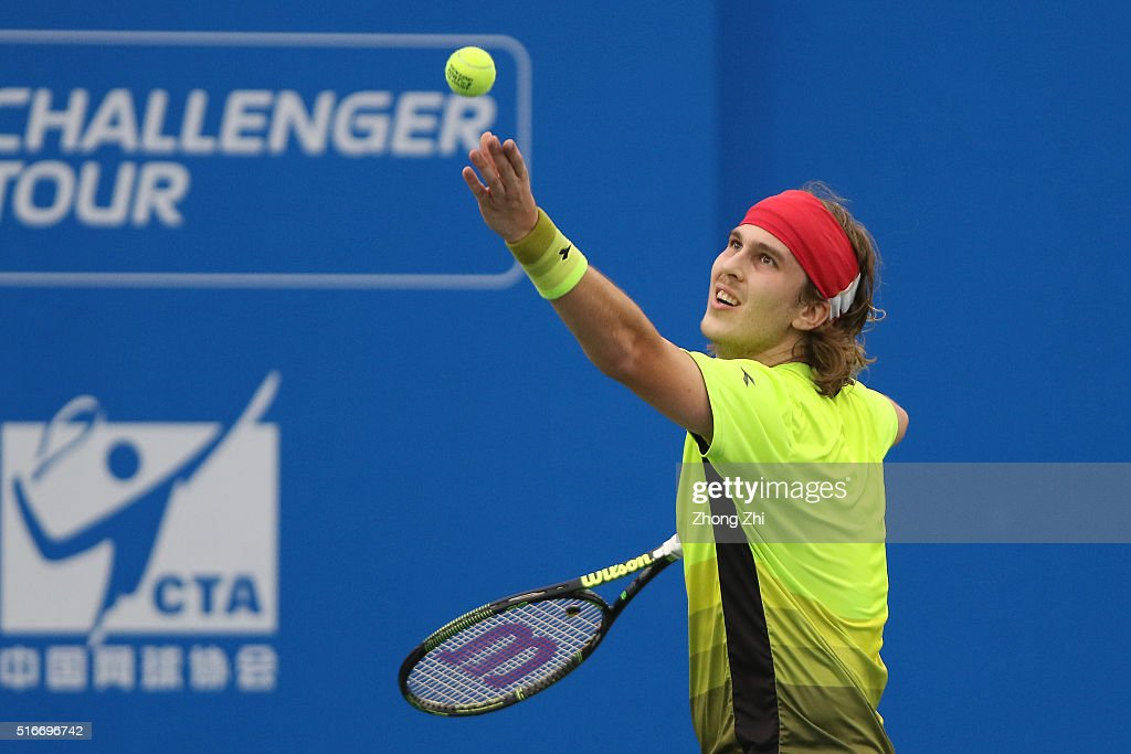 Lukas Lacko of Slovakia serves during the match against Ze Zhang of China during the 2016 'GDD CUP' International ATP Challenger Guangzhou Tour Day 6 at Guangzhou Development District International Tennis School on March 20, 2016 in Guangzhou, China.