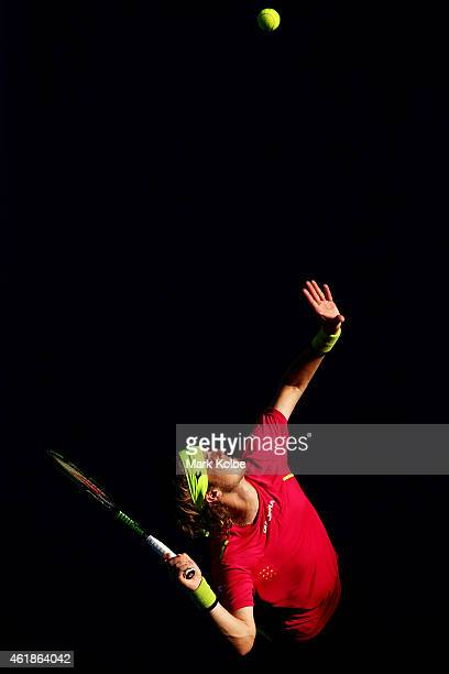 Lukas Lacko of Slovakia serves in his second round match against Grigor Dimitrov of Bulgaria during day three of the 2015 Australian Open at...