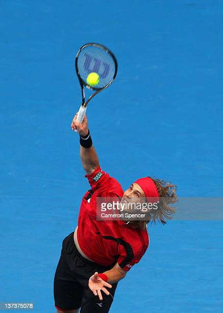 Lukas Lacko of Slovakia serves in his third round match against Rafael Nadal of Spain during day five of the 2012 Australian Open at Melbourne Park...