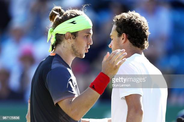 Lukas Lacko of Slovakia talks to Marco Cecchinato of Italy after winning the semifinal match on day eight of the Nature Valley International at...