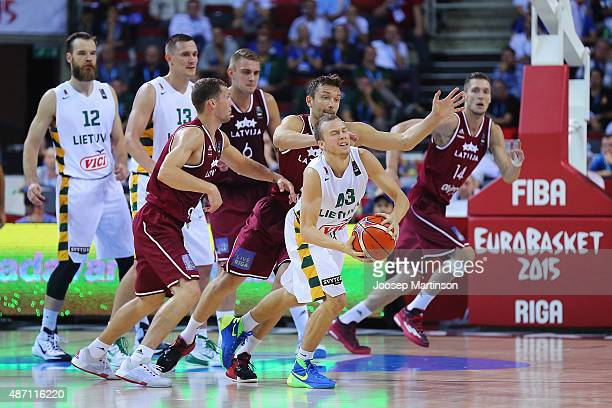 Lukas Lekavicius of Lithuania is fouled during the FIBA EuroBasket 2015 Group D basketball match between Latvia and Lithuania at Arena Riga on...
