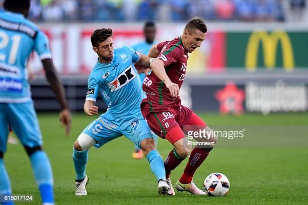 Lukas Lerager midfielder of SV Zulte Waregem is challenged by Brecht Dejaegere midfielder of KAA Gent during the Jupiler Pro League match between KAA...