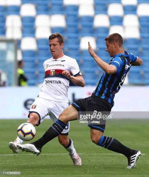 Lukas Lerager of Genoa CFC competes for the ball with of Mario Pasalic during the Serie A match between Atalanta BC and Genoa CFC at Mapei Stadium...