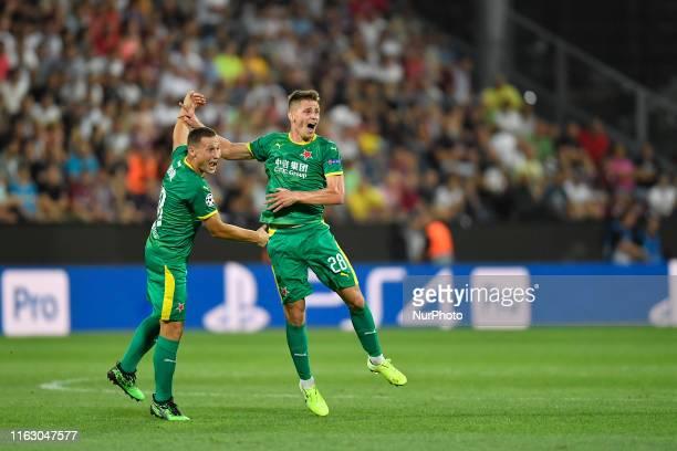Lukas Masopust and Jan Boril of Slavia Praha celebrate during UEFA Champions League 2019/2020 PlayOffs 1st leg between CFR Cluj and SK Slavia Praha...
