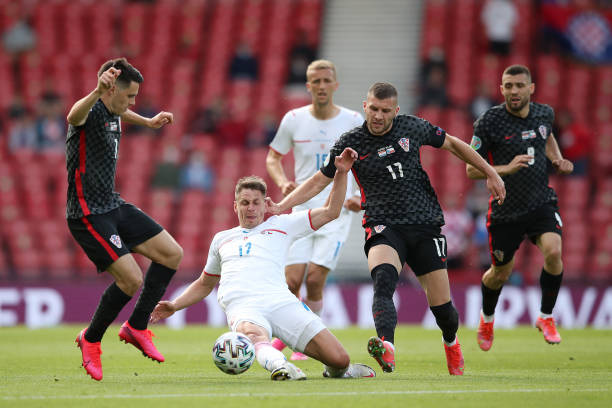 Lukas Masopust of Czech Republic stretches for the ball whilst under pressure from Josip Brekalo and Ante Rebic of Croatia during the UEFA Euro 2020...