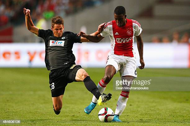 Lukas Masopust of FK Baumit Jablonec tackles Riechedly Bazoer of Ajax during the UEFA Europa League play off round 1st leg match between Ajax...