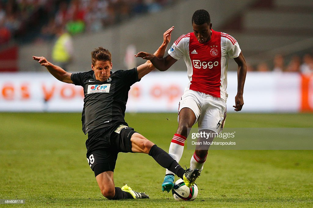 Lukas Masopust of FK Baumit Jablonec tackles Riechedly Bazoer of Ajax during the UEFA Europa League play off round 1st leg match between Ajax Amsterdam and FK Baumit Jablonec on August 20, 2015 in Amsterdam, Netherlands.