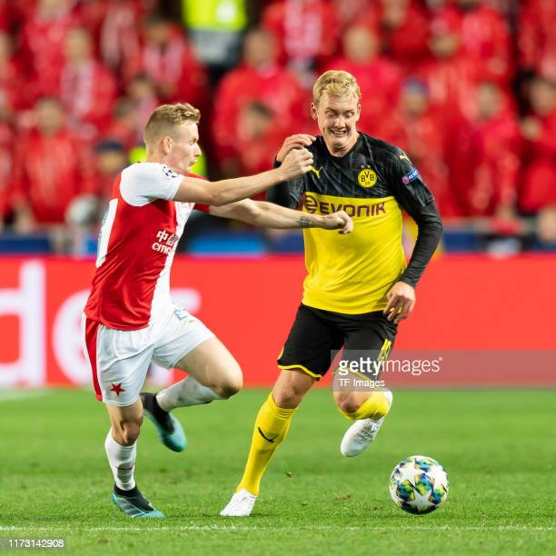Lukas Masopust of Slavia Praha and Julian Brandt of Borussia Dortmund battle for the ball during the UEFA Champions League group F match between...