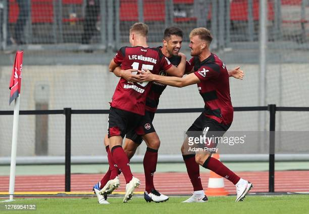Lukas Muehl of 1 FC Nuernberg is congratulated after scoring the first goal during the Second Bundesliga match between 1 FC Nürnberg and SV...