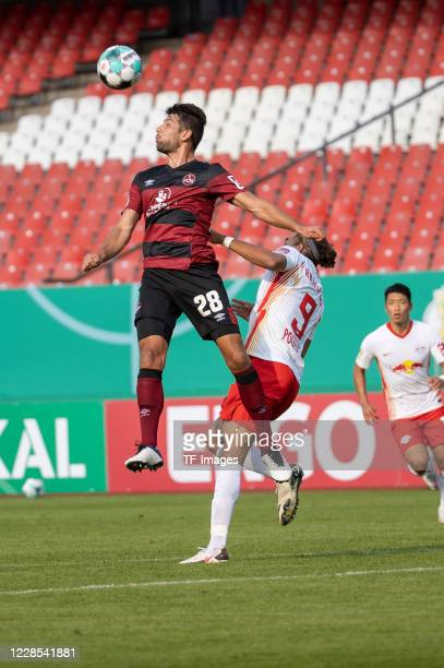 Lukas Muehl of 1FC Nuernberg and Yussuf Poulsen of RB Leipzig during the DFB Cup first round match between 1 FC Nuernberg and RB Leipzig at...