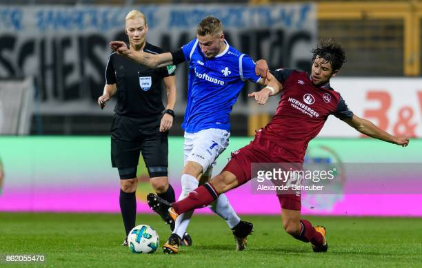 Lukas Muehl of Nuernberg challenges Felix Platte of Darmstadt during the Second Bundesliga match between SV Darmstadt 98 and 1 FC Nuernberg at...