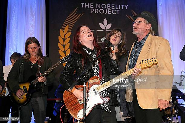 Lukas Nelson Carolyn Wonderland Amy Nelson and Butch Hancock perform during the Feed The Peace Awards banquet at the Four Seasons Hotel on February 9...