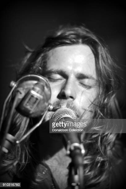 Lukas Nelson of the rock and roll band Lukas Nelson and the Promise of the Real performs onstage at a houseparty on November 29 2013 in Topanga...
