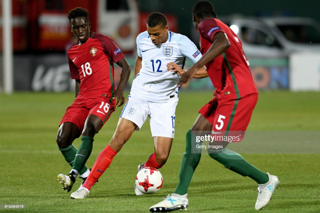 Lukas Nmecha of England in action with Quina (l) and Abdu Conte (r) of Portugal during the UEFA European Under-19 Championship Final between England and Portugal on July 15, 2017 in Gori, Georgia.