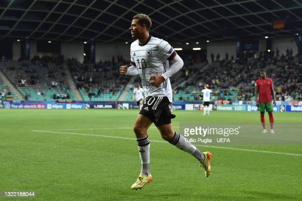 Lukas Nmecha of Germany celebrates after scoring their side's first goal during the 2021 UEFA European Under-21 Championship Final match between...