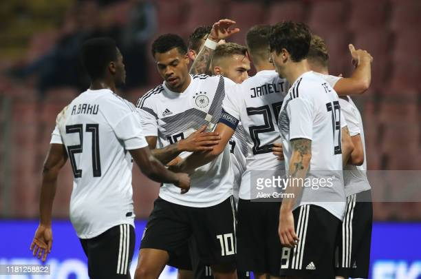 Lukas Nmecha of Germany celebrates as he scores his team's second goal with team mates during the UEFA U21 Championship Qualifying match between...