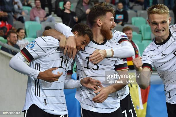 Lukas Nmecha of Germany celebrates with team mate Salih Ozcan after scoring their side's first goal during the 2021 UEFA European Under-21...