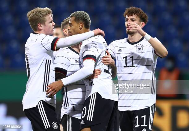 Lukas Nmecha of Germany celebrates with teammates after scoring his teams first goal from the penalty spot during the UEFA Euro Under 21 Qualifier...