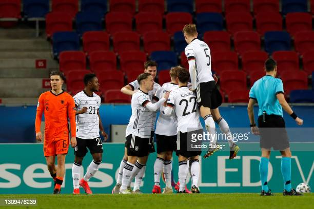 Lukas Nmecha of Germany celebrates with teammates after scoring their team's first goal during the 2021 UEFA European Under-21 Championship Group A...