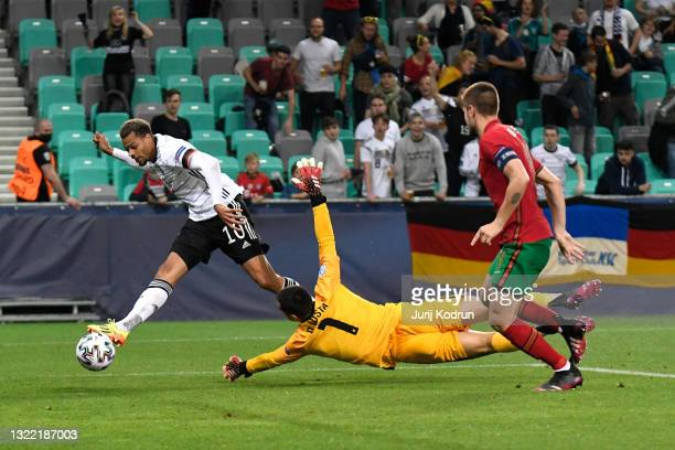 Lukas Nmecha of Germany scores their side's first goal past Diogo Costa of Portugal during the 2021 UEFA European Under-21 Championship Final match...