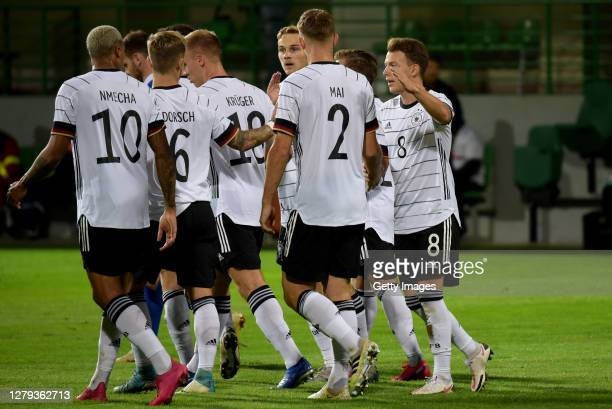 Lukas Nmecha of Germany U21 celebrates with his team mates after scoring his teams first goal during the UEFA Euro Under 21 Qualifier match between...