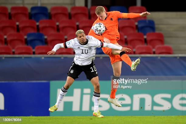 Lukas Nmecha of Germany U21, Per Schuurs of The Netherlands U21 during the UEFA Under 21 Euro Championship Group Stage match between Germany U21 and...