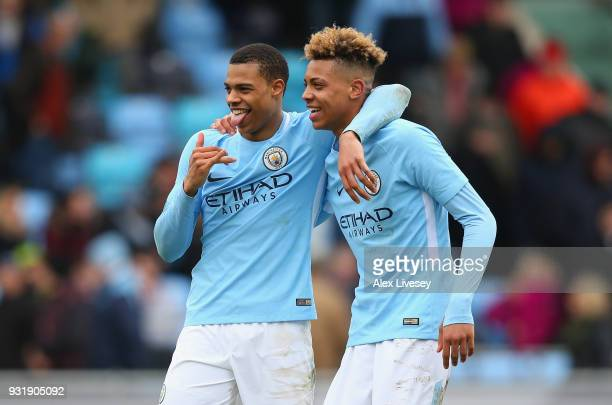 Lukas Nmecha of Manchester City and Felix Nmecha of Manchester City celebrate after winning on a penalty shoot out during the UEFA Youth League...