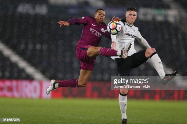 Lukas Nmecha of Manchester City and Max Hunt of Derby County during the Premier League 2 match between Derby County and Manchester City on March 9...