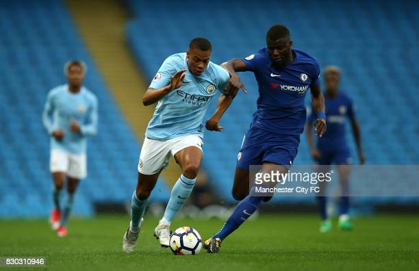 Lukas Nmecha of Manchester City battles with Joseph Colley of Chelsea during the Premier League 2 match between Manchester City and Chelsea at Etihad...