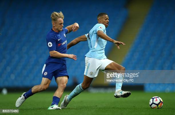 Lukas Nmecha of Manchester City battles with Luke McCormick of Chelsea during the Premier League 2 match between Manchester City and Chelsea at...