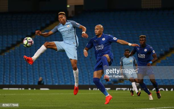 Lukas Nmecha of Manchester City is challenged by Yohan Benalouane of Leicester City