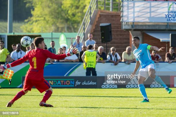 Lukas Nmecha of Manchester City scores goal against Goalie Ignacio Pena of FC Barcelona during the semifinal football match between Manchester City...