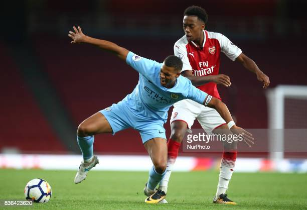 Lukas Nmecha of Manchester City Under 23s holds of Joe Willock of Arsenal U23s during Premier League 2 match between Arsenal Under 23s against...