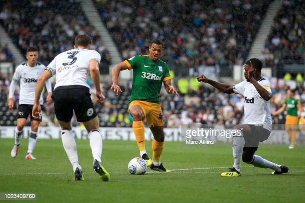 Lukas Nmecha of Preston North End in action with Craig Forsyth and Fikayo Tomori of Derby County during the Sky Bet Championship match between Derby...