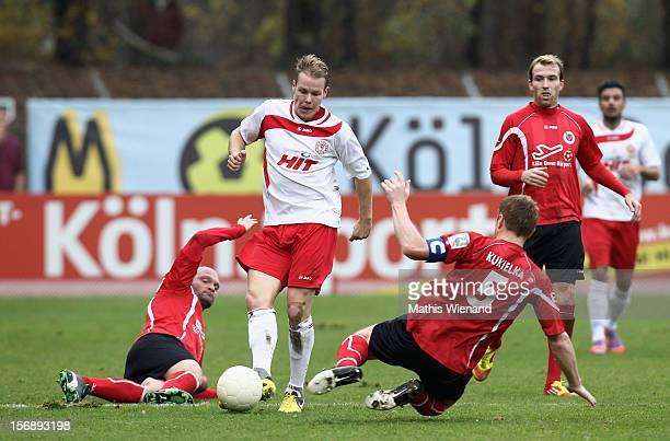 Lukas Nottbeck of Fortuna Koeln and Alexander Voigt with Mariusz Kukielka of Viktoria Koeln battles for the ball during the match between Viktoria...