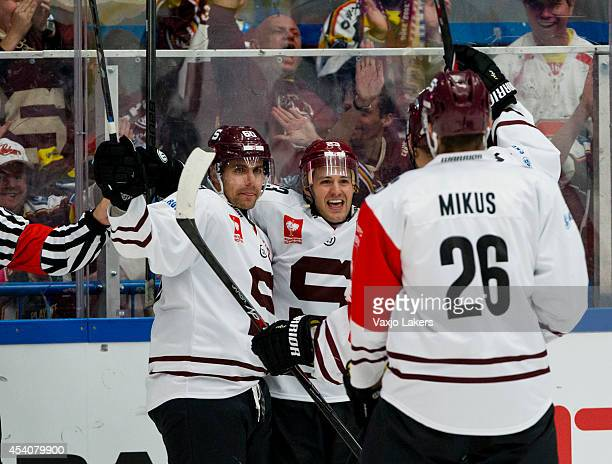 Lukas Pech of Sparta Prague celebrates after scoring to make it 2-4 and is congratulated by team mates Tomas Rolinek and Juraj Mikus during the...