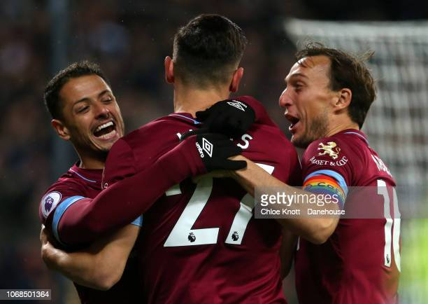 LONDON ENGLAND DECEMBER 04 Lukas Perez of West Ham United celebrates scoring his teams first goal during the Premier League match between West Ham...