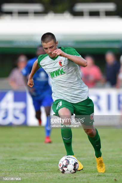 Lukas Petkov of Augsburg plays the ball during the preseason friendly match between SC Olching and FC Augsburg on July 19 2018 in Olching Germany