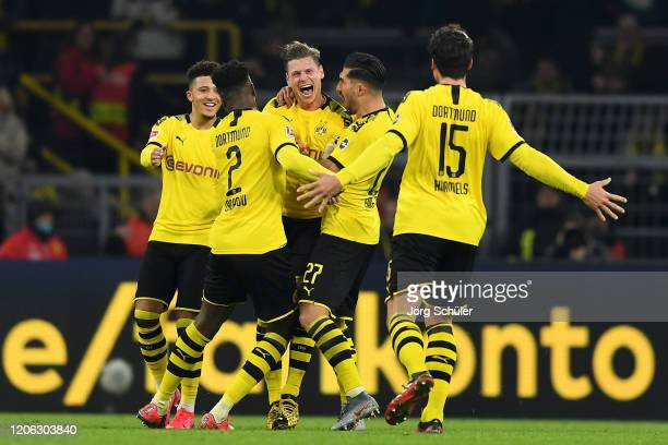 Lukas Piszczek of Dortmund celebrates his team's first goal with team mates during the Bundesliga match between Borussia Dortmund and Eintracht...