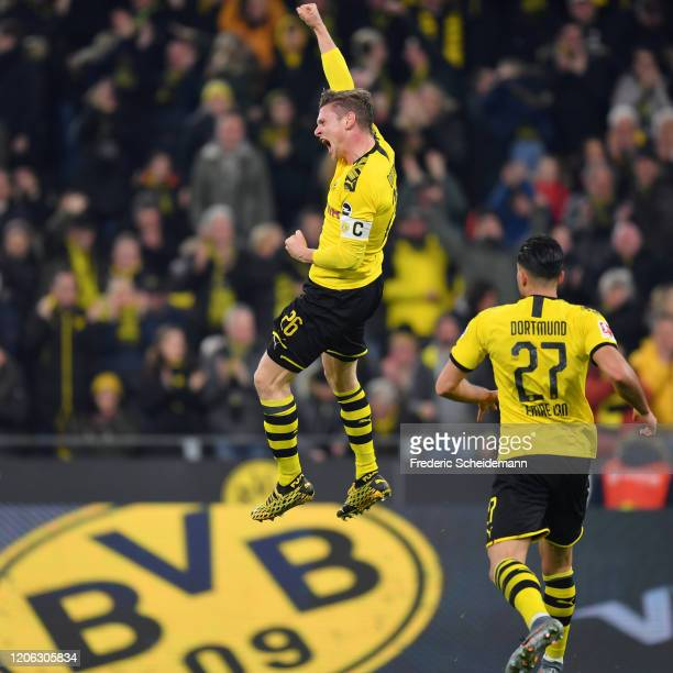 Lukas Piszczek of Dortmund celebrates his team's first goal with team mate Emre Can during the Bundesliga match between Borussia Dortmund and...
