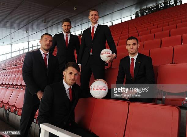 Lukas Podolski Aaron Ramsey Olivier Giroud Per Mertesacker and Thomas Vermaelen of Arsenal attend the Arsenal Foundation Charity Ball at Emirates...