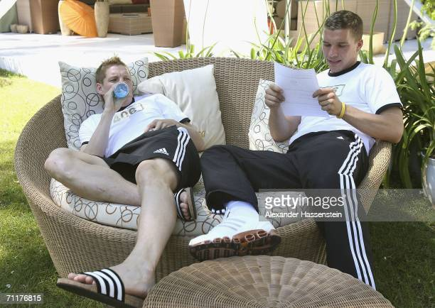 Lukas Podolski and Bastian Schweinsteiger of Germany realxing at the Hotel Garden during a rest day of the Germany National Team at the squad hotel...
