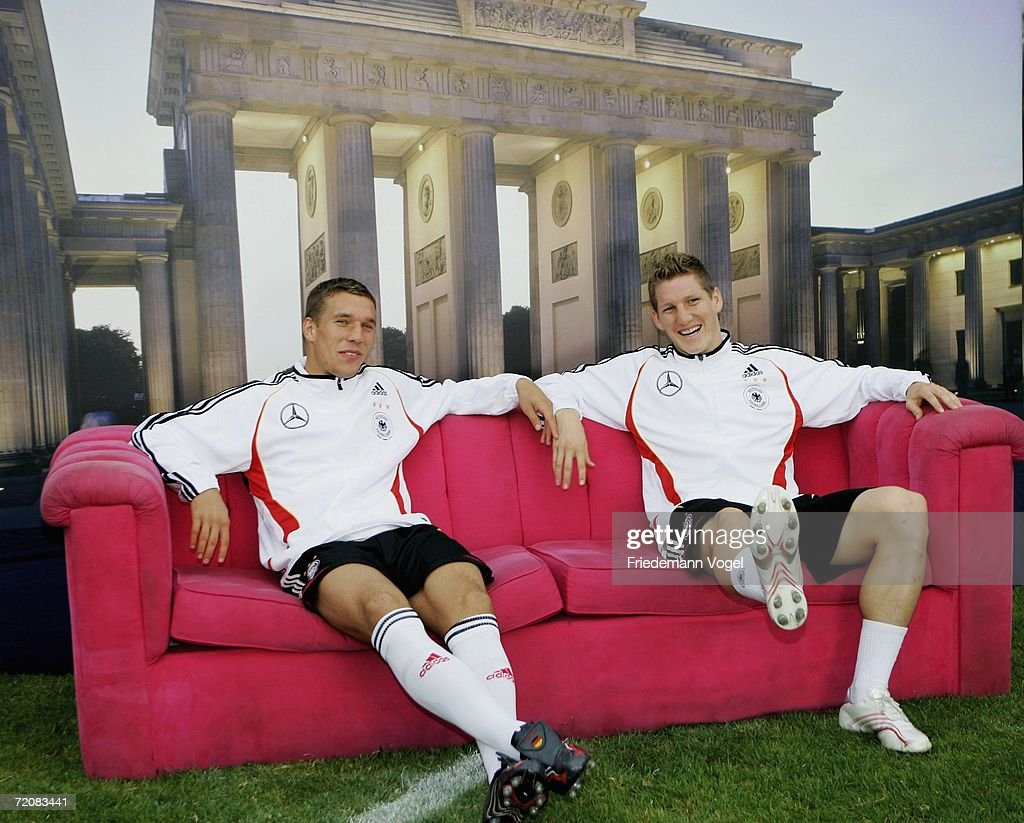 Lukas Podolski and Bastian Schweinsteiger pose for a photographer before the German National Team training session at the Olympic stadium training ground on October 4, 2006 in Berlin, Germany.