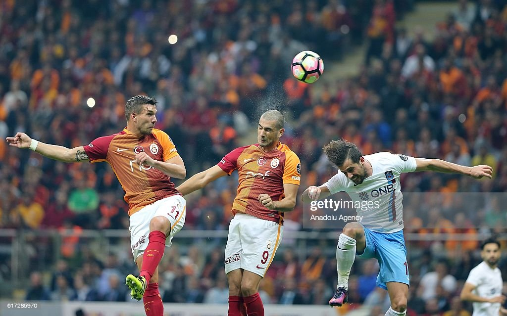 Lukas Podolski (L) and Eren Derdiyok (C) of Galatasaray in action during Turkish Spor Toto Super Lig match between Galatasaray and Trabzonspor at Turk Telekom Arena Stadium in Istanbul, Turkey on October 22, 2016.