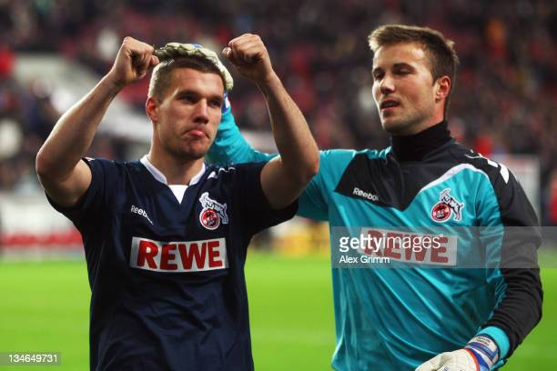 Lukas Podolski and goalkeeper Michael Rensing of Koeln celebrate with supporters after the Bundesliga match between VfB Stuttgart and 1 FC Koeln at...