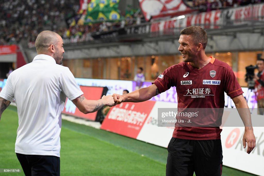 Lukas Podolski (R) and Leandro (L) of Vissel Kobe high fives prior to the J.League J1 match between Vissel Kobe and Kashima Antlers at Noevir Stadium Kobe on August 9, 2017 in Kobe, Hyogo, Japan.